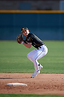 Robert Moore during the Under Armour All-America Pre-Season Tournament, powered by Baseball Factory, on January 19, 2019 at Sloan Park in Mesa, Arizona.  Robert Moore is a shortstop from Leawood, Kansas who attends Shawnee Mission East High School and is committed to Arkansas.  (Mike Janes/Four Seam Images)