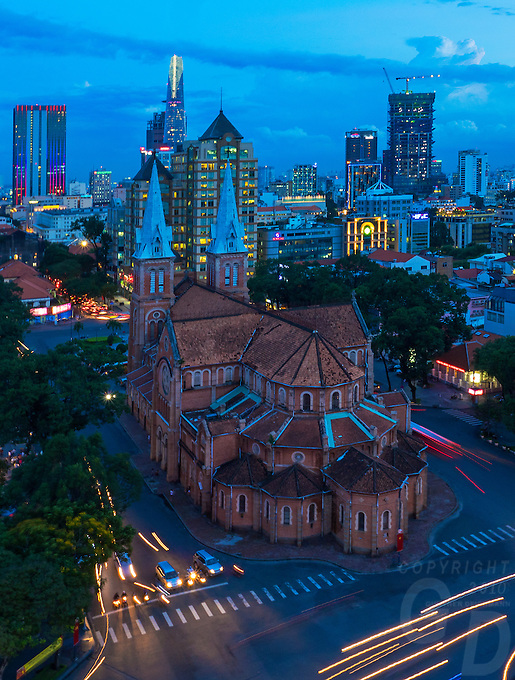 Birds Eye View of Saigon (Ho Chi Minh City, HCMC) and the stunning Notre-Dame Cathedral Basilica of Saigon (Vietnamese: Vương cung thánh đường Chính tòa Đức Bà Sài Gòn or Nhà thờ Đức Bà Sài Gòn; French: Basilique-Cathédrale Notre-Dame de Saigon),  is a cathedral located in the downtown of Ho Chi Minh City, Vietnam. Established by French colonists who initially named it Cathédrale Notre-Dame de Saïgon, the cathedral was constructed between 1863 and 1880. It has two bell towers, reaching a height of 58 meters (190 feet).