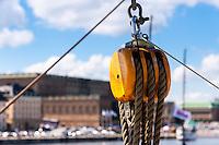 Sweden, Stockholm. Veteran boats. Stockholm Castle in the background.