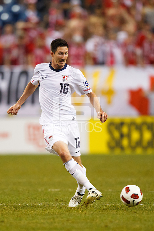 7 June 2011: USA Men's National Team midfielder Sacha Kljestan (16) passes the ball during the CONCACAF soccer match between USA MNT and Canada MNT at Ford Field Detroit, Michigan. USA won 2-0.