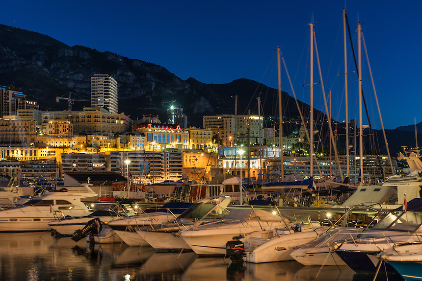 Marina yachts and downtown Monte Carlo at night, Monaco