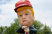 Members of the protest group Code Pink set up a statue of United States President Donald J. Trump tweeting from a golden toilet in Washington D.C., U.S. on July 4, 2019, to protest his Salute to America speech.  The group believes the president's participation in 4th of July celebrations is politicizing a non-political holiday.<br /> <br /> Credit: Stefani Reynolds / CNP