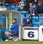 Kenny Shiels sitting down in the stand