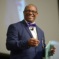 NWA Democrat-Gazette/ANDY SHUPE<br /> John L Colbert, superintendent of Fayetteville Public School, welcomes teachers, staff and administrators Friday, Aug. 10, 2018, during Fayetteville Public Schools annual Convocation ceremony in Bulldog Arena on the Fayetteville High School campus. The event, which features performances by a combined choir and the high school band as well as awards and presentations, serves as a kickoff to the school year which begins Monday.