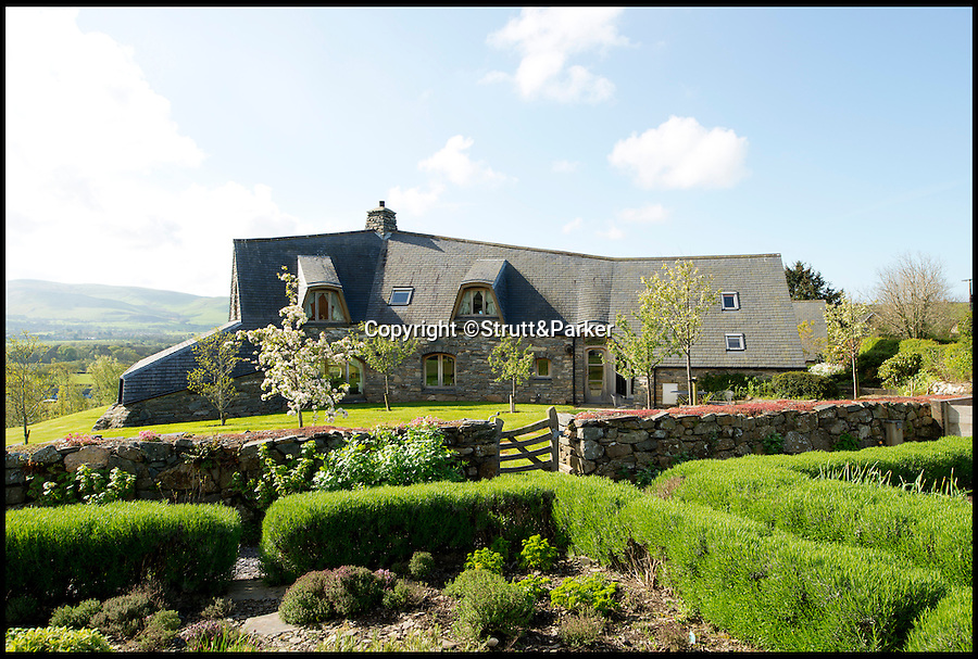 BNPS.co.uk (01202 558833)<br /> Pic: Strutt&amp;Parker/BNPS<br /> <br /> ***Please use full byline***<br /> <br /> A stunning country pad that looks like it could have been designed by Hobbit hero Bilbo Baggins has gone on the market for one million pounds.<br /> <br /> The wonderfully wacky house appears to blend in with its surroundings, just like the Lord of the Rings character's humble Hobbit hole.<br /> <br /> The plush five-bedroom property is nestled deep in the rolling hills of Wales' Snowdonia National Park - although it would not look out of place in Middle Earth.<br /> <br /> The house is called Cynefin, meaning 'a sense of place' in Welsh, and is in the tiny village of Llanegryn in Gwynedd wih unrivalled views over the Dysynni Valley.<br /> <br /> It is on the market through estate agents Strutt and Parker for &pound;985,000.