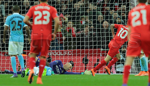 28.02.2016. Wembley Stadium, London, England. Capital One Cup Final. Manchester City versus Liverpool. Liverpool Midfielder Philippe Coutinho scores past Manchester City Goalkeeper Wilfredo Caballero, 1-1