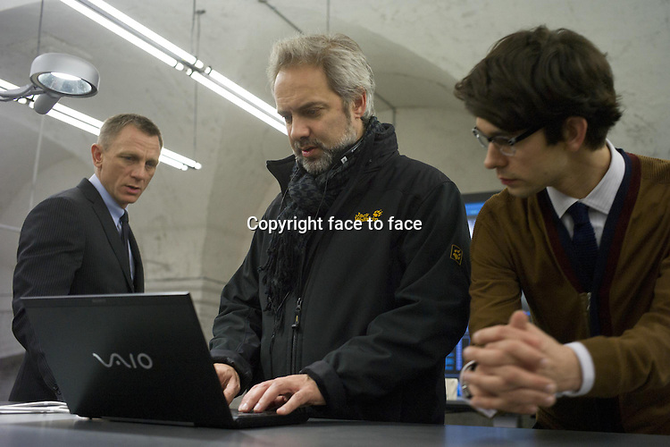 Daniel Craig with Director Sam Mendes and Ben Whishaw on the set of Skyfall...- Editorial Use Only -..Supplied by face to face