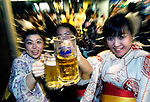 Women enjoy beer at a beer garden located on the roof of a department store in Tokyo, Japan.