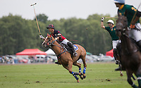 Apichet Srivaddhanaprabha (King Power) scores the winning goal to make it 11-10 during the Cartier Trophy Final match between King Power and Salkeld at the Guards Polo Club, Windsor, Smith's Lawn, England on 14 June 2015. Photo by Andy Rowland.