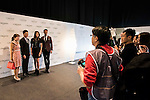 Photographers take photos of (2nd from L-R) Freeyon Chung, Mr Hong Kong 2016 second runner-up, Tiffany Lau, Miss Hong Kong 2016 first runner-up, and Jackson Lai, Mr Hong Kong 2016, as they arrive at the Longines Masters of Hong Kong 2017 on 12 February 2017 at the AsiaWorld Expo in Hong Kong, China. Photo by Weixiang Lim / Power Sport Images