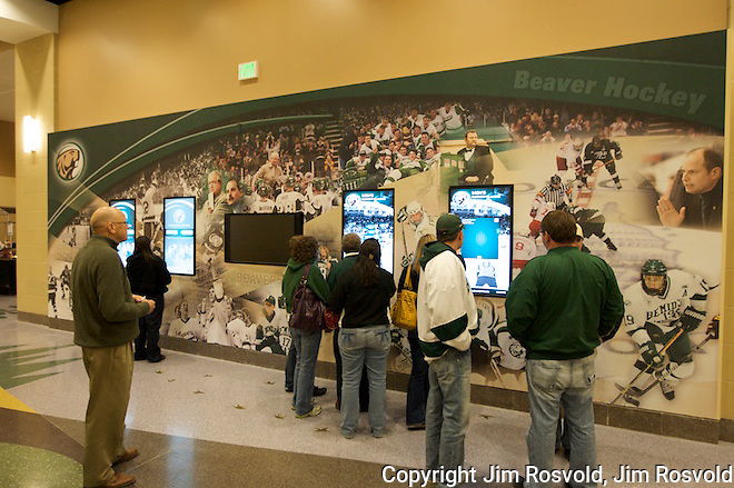 Fans using interactive video boards on display in the concourse.