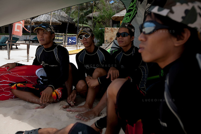 From left, STORM Kiteboarding employees Hung, Binh, Tuan and Doi wait for the wind to pick up so they can teach kite surfing in Mui Ne.