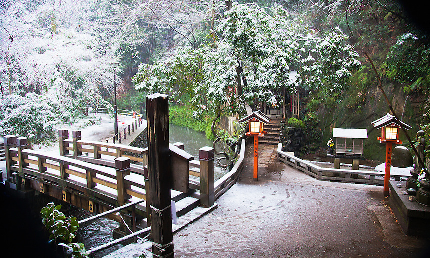 Todoroki Valley`s Fudo Buddhist temple with a sprinkling of snow.