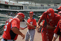 GCL Nationals manager Patrick Anderson (15) gets water dumped over his head after his team defeated the GCL Red Sox in the league championship series on September 1, 2013 at JetBlue Park in Fort Myers, Florida.  GCL Nationals defeated the GCL Red Sox 7-2 sweeping the best of three series.  (Greg Wagner/Four Seam Images)