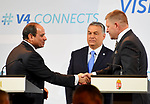Hungarian Prime Minister Viktor Orban looks on as Egyptian President Abdel Fattah al-Sisi and Slovakian Prime Minister Robert Fico shake hands ahead of a joint press conference in Budapest on July 4, 2017 during a summit of the Visegrad group countries (V4) and Egypt. Photo by Egyptian President Office