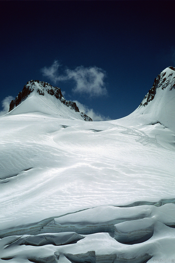 Crevasses cut across an alpine glacier, found on the Mont Blanc Massif, between Courmayeur, Italy, and Chamonix, France.