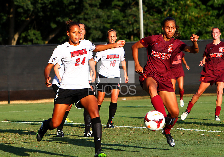 WINSTON-SALEM, NORTH CAROLINA - August 30, 2013:<br />  Rachel Melhado (24) of Louisville University goes for a loose ball with Jazmine Reeves (5) of Virginia Tech during a match at the Wake Forest Invitational tournament at Wake Forest University on August 30. The game ended in a 1-1 tie.