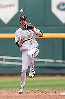 Vanderbilt Commodores shortstop Dansby Swanson (7) warms up before the NCAA College baseball World Series against the Cal State Fullerton Titans on June 15, 2015 at TD Ameritrade Park in Omaha, Nebraska. Vanderbilt beat Cal State Fullerton 4-3. (Andrew Woolley/Four Seam Images)