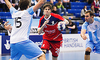 05 APR 2012 - LONDON, GBR - Great Britain's Gawain Vincent (GBR) (centre, #28, in red and blue) looks for a way through the Argentinian defence during the men's 2012 London Cup match at the National Sports Centre in Crystal Palace, Great Britain .(PHOTO (C) 2012 NIGEL FARROW)
