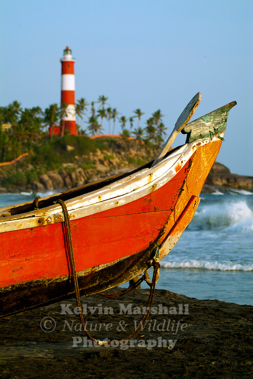 A local fishing boat tied up on the Lighthouse beach, Kovalam - Kerala (Southern India)