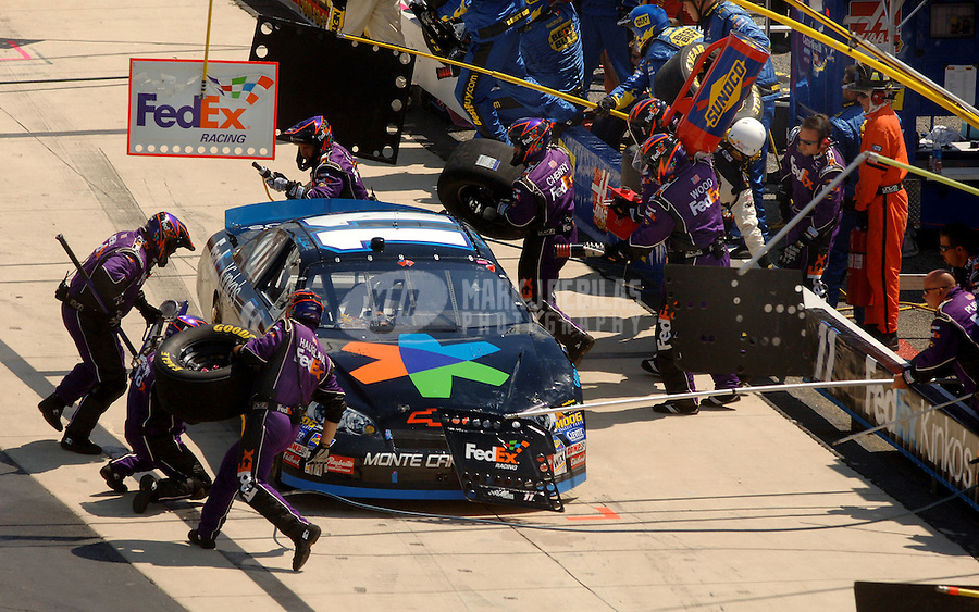 June 4, 2006; Dover, DE, USA; Nascar Nextel Cup driver Denny Hamlin (11) pits during the Neighborhood Excellence 400 at Dover International Speedway. Mandatory Credit: Mark J. Rebilas..