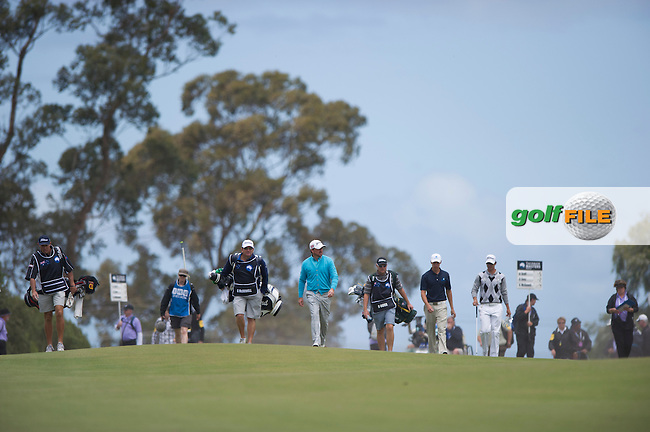 The main group of Graeme McDowell, Adam Scott and Oliver Goss at Kingston Heath during the second round of the Australian Masters (Photo: Anthony Powter) www.golffile.ie
