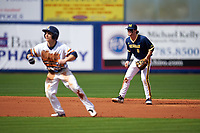 Michigan Wolverines shortstop Michael Brdar (9) on defense as Tim Kensinger (10) leads off second base during the second game of a doubleheader against the Canisius College Golden Griffins on February 20, 2016 at Tradition Field in St. Lucie, Florida.  Michigan defeated Canisius 3-0.  (Mike Janes/Four Seam Images)