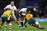 Maro Itoje of England is tackled by Tolu Latu of Australia. Quilter International match between England and Australia on November 24, 2018 at Twickenham Stadium in London, England. Photo by: Patrick Khachfe / Onside Images