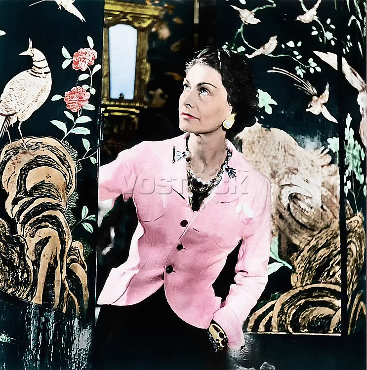 GABRIELLE 'COCO' CHANEL (1883-1971). French fashion designer. Photographed in her suite at the Ritz Hotel in Paris, c 1937.