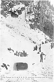 Snow tunnel on Silverton Branch with many workmen present.  The tunnel is not large enough for equipment to pass.<br /> D&amp;RG  Silverton Branch, CO