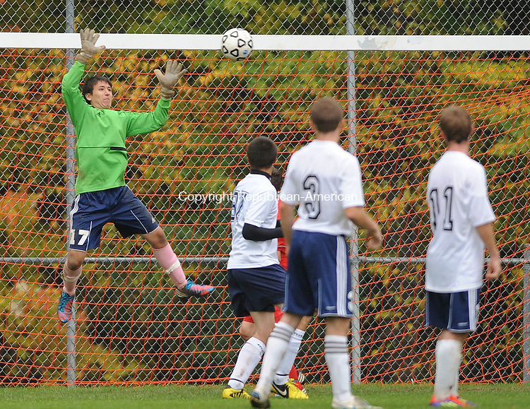 BURLINGTON, CT-15 OCTOBER 2012--10152JS09--Wolcott Tech goalkeeper Jeff Bosworth (17) makes a save during their game against University/Prince Tech Monday at the Nassahegan Rec Complex in Burlington. .Jim Shannon Republican-American