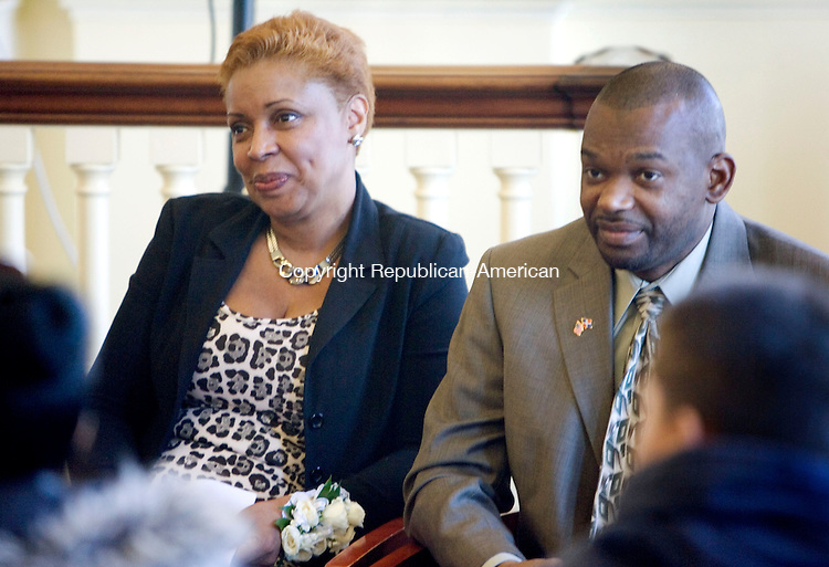 WATERBURY CT. 28 February 2014-022814SV02-Yolanda Amancio of Waterbury, Mayor of the Day, and her husband, Max Amancio , listen to speakers during the Dominican Mayor for the Day ceremony in Waterbury Friday. <br /> Steven Valenti Republican-American
