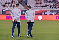 , FL - : Vlatko Andonovski and Milan Ivanovic of the United States walk the field during a game between  at  on ,  in , Florida.