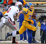 BROOKINGS, SD - NOVEMBER 22:  Zach Zenner #31 from South Dakota State University breaks loose for a touchdown past Micheal Lilly #2 from the University of South Dakota in the first half of their game Saturday at Coughlin Alumni Stadium in Brookings. (Photo by Dave Eggen/Inertia)