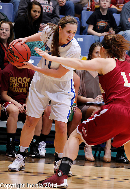 SIOUX FALLS, SD - MARCH 9:  Amanda Hyde #11 of IPFW looks for room to drive against a Denver defender during their quarterfinal game at the 2014 Summit League Basketball Championships Sunday at the Sioux Falls Arena.  (Photo by Dick CarlsonInertia)