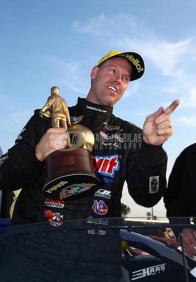 Feb 9, 2014; Pomona, CA, USA; NHRA pro stock driver Jason Line celebrates after winning the Winternationals at Auto Club Raceway at Pomona. Mandatory Credit: Mark J. Rebilas-