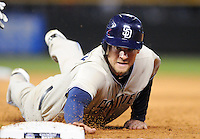 10 April 2010: San Diego Padres left fielder Chase Headley dives back to first base to avoid a pickoff during a Major League Baseball game between the Colorado Rockies and the San Diego Padres at Coors Field in Denver,  Colorado. *****For Editorial Use Only*****