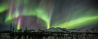 Aurora borealis over the Brooks Range mountains in Alaska's Arctic.