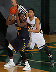 SPEARFISH, SD - DECEMBER 21, 2013:  Jon Conley #4 of Regis backs into pressure from Yoshio Allen #24 of Black Hills State during their Rocky Mountain Athletic Conference game Saturday at the Donald E. Young Center in Spearfish, S.D.  (Photo by Dick Carlson/Inertia)