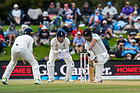 Colin De Grandhomme of the Black Caps blocks a ball with Jonny Bairstow of England looking on during the final day of the Second International Cricket Test match, New Zealand V England, Hagley Oval, Christchurch, New Zealand, 3rd April 2018.Copyright photo: John Davidson / www.photosport.nz