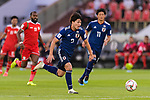 Minamino Takumi of Japan runs with the ball during the AFC Asian Cup UAE 2019 Group F match between Oman (OMA) and Japan (JPN) at Zayed Sports City Stadium on 13 January 2019 in Abu Dhabi, United Arab Emirates. Photo by Marcio Rodrigo Machado / Power Sport Images