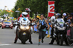 Photographer Iri Greco runs to catch the start in Mondorf-les-Bains of Stage 4 of the 104th edition of the Tour de France 2017, running 207.5km from Mondorf-les-Bains, Luxembourg to Vittel, France. 4th July 2017.<br /> Picture: Eoin Clarke | Cyclefile<br /> <br /> <br /> All photos usage must carry mandatory copyright credit (&copy; Cyclefile | Eoin Clarke)