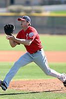 Scott Kazmir #19 of the Los Angeles Angels participates in pitchers fielding practice during spring training workouts at the Angels complex on February 16, 2011  in Tempe, Arizona. .Photo by:  Bill Mitchell/Four Seam Images.