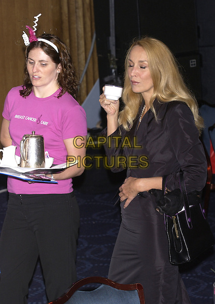 JERRY HALL.Arriving  to host the Breast Cancer Care Fashion Show at Grosvenor House, Park Lane, London, October 6th 2004..half length drinking cup.Ref: PL.www.capitalpictures.com.sales@capitalpictures.com.©Capital Pictures.