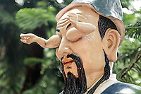Statue of a man with arms coming out of his eye sockets along trail to Ten Thousand Buddhas, Sha Tin, New Territories, Hong Kong SAR, People's Repbulic of China, Asia