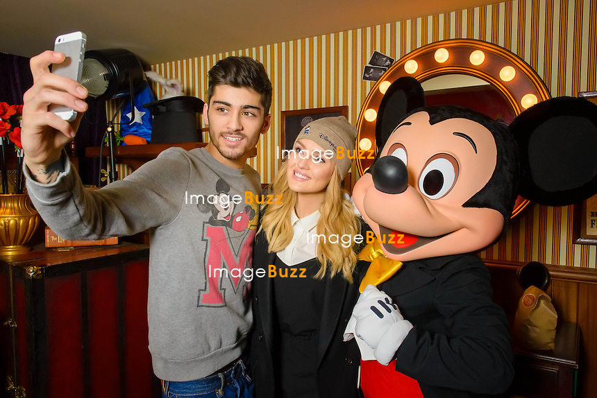 Zayn Malik ( One Direction) and Perrie Edwards ( Little Mix) escaped two days to Disneyland Paris. A surprise for the young singer, offered by his beautiful a few days away from its 21st birthday. he couple enjoyed a few rides, watched the Disney Dream fireworks, and at night stayed at the Disneyland hotel! <br /> France, Paris, January 8, 2014.