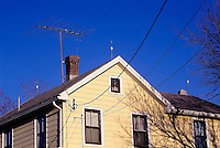 LIGHTNING ROD<br /> Three lightning rods on top of house and television antennae. Lightning rods form a low-resistance path for the lightning  discharge and prevent it from traveling through the structure