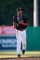 Batavia Muckdogs center fielder Brayan Hernandez (18) jogs back to the dugout during a game against the West Virginia Black Bears on June 20, 2018 at Dwyer Stadium in Batavia, New York.  West Virginia defeated Batavia 4-3.  (Mike Janes/Four Seam Images)