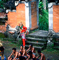 Colourfully dressed participants in the historical monkey dance taking place in the historical religous shrines and temples of Bali, Indonesia, 1980
