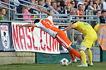02 May 2015: Carolina's Kupono Low (3) is knocked off of the ball by Tampa Bay's Zak Boggs (33). The Carolina RailHawks hosted the Tampa Bay Rowdies at WakeMed Stadium in Cary, North Carolina in a North American Soccer League 2015 Spring Season match. The game ended in a 1-1 tie.